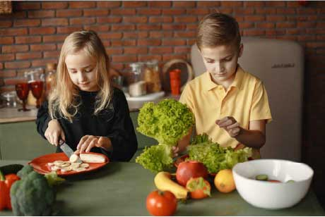 Family enjoys leafy greens in the kitchen 2